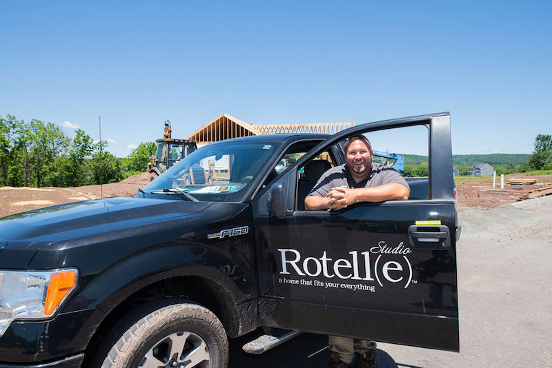 Rotelle truck parked outside of custom home under construction