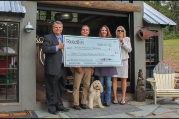 Peter Rotelle holding big check dedicated to the Ashley Addiction Treatment Center